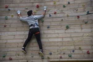 Young boy climbing on climbing wall